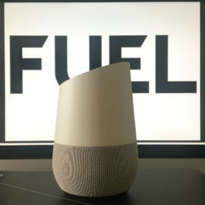 Google Home In front Of A Fuel Logo