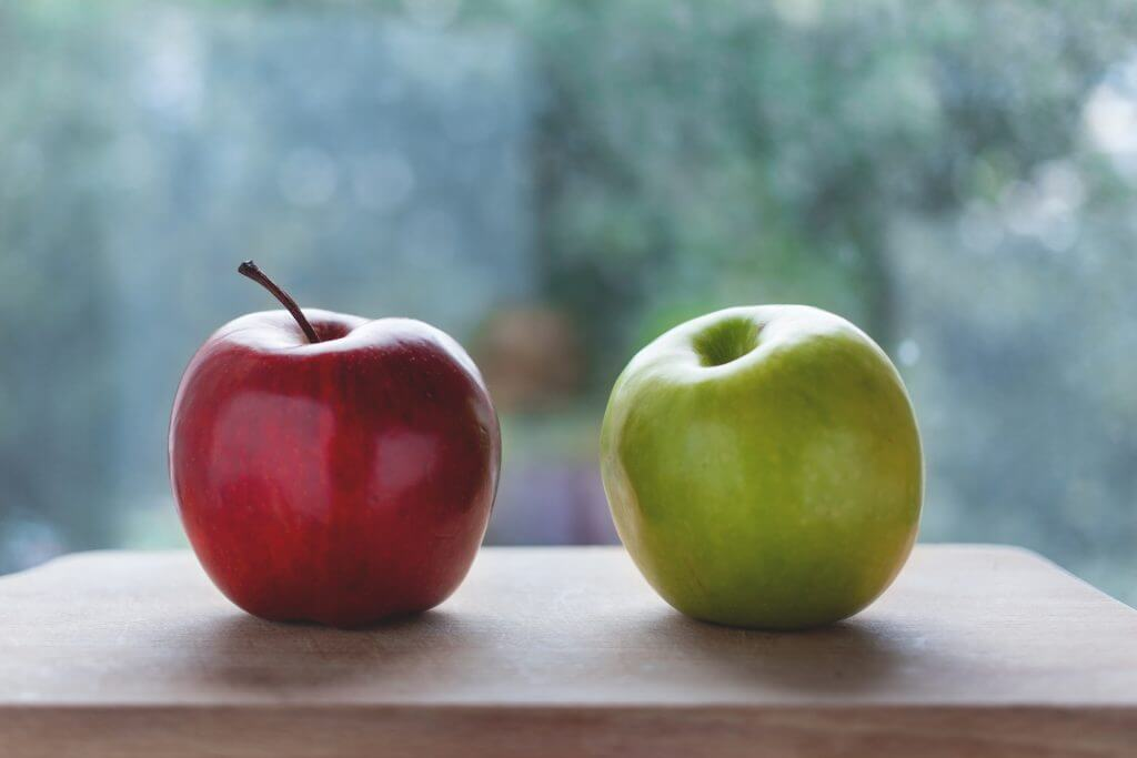 A Red Apple And A Green Apple