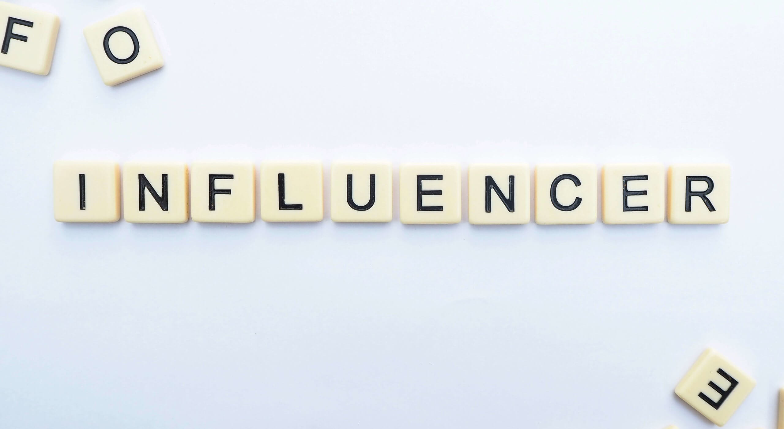 Influencer Marketing Spelled Out With Scrabble Tiles