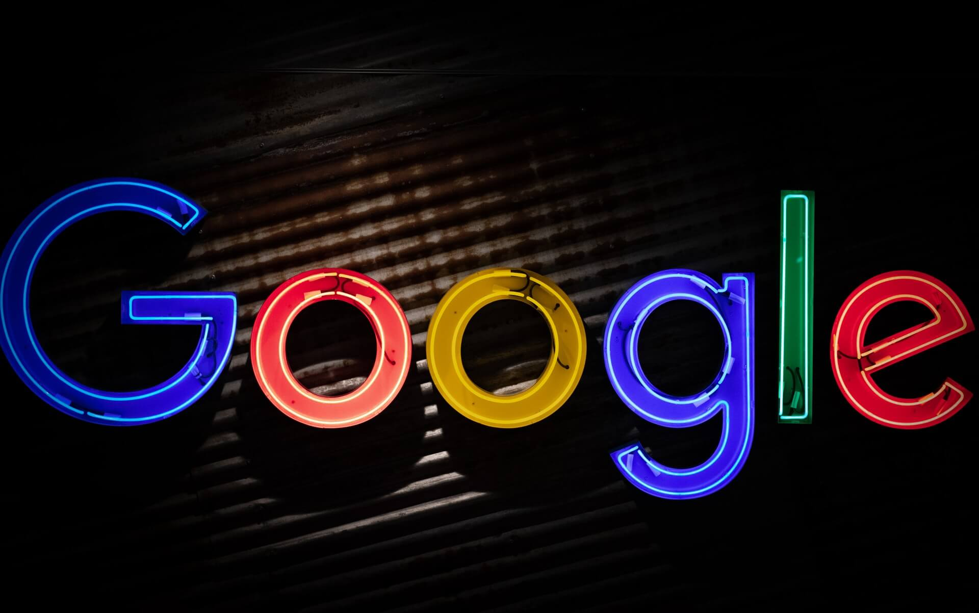 Free Google Ad Credits Available Over A Lit Up Google Logo