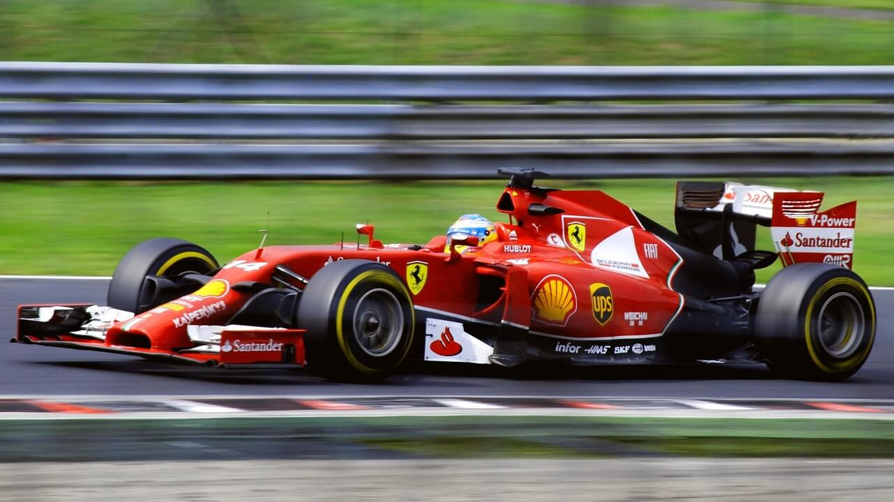 Ferrari F1 car racing around a track