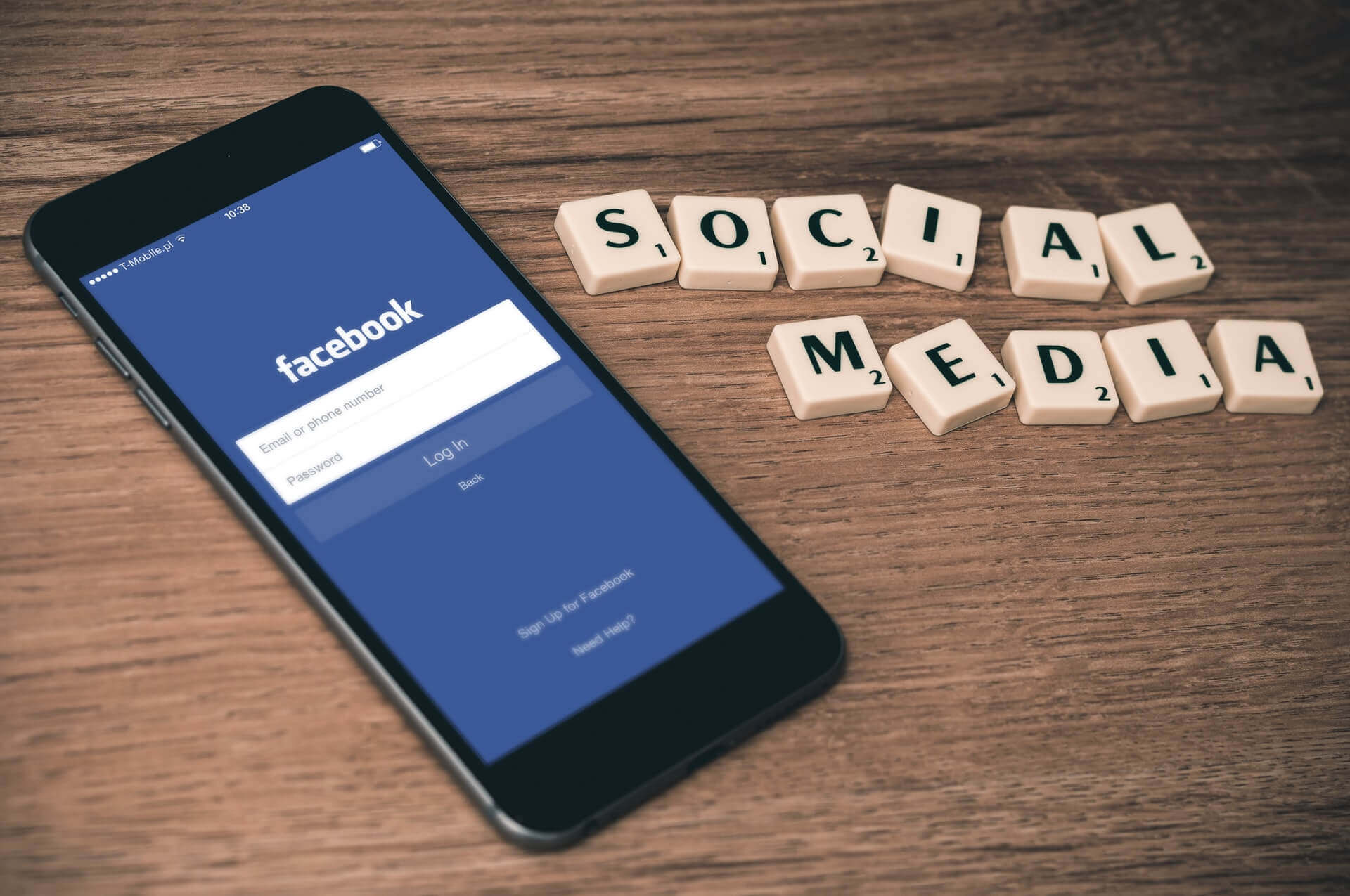 """Facebook Ads Data Banner - Mobile with Facebook App next to scrabble tiles spelling out """"Social Media"""""""
