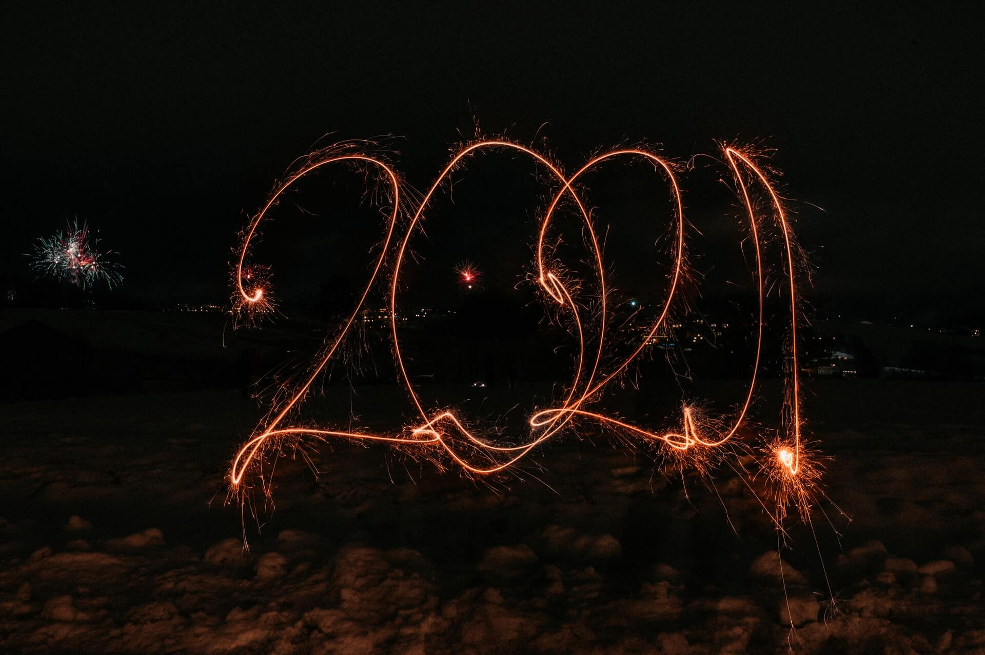 a long-exposure shot of a sparkler writing 2021