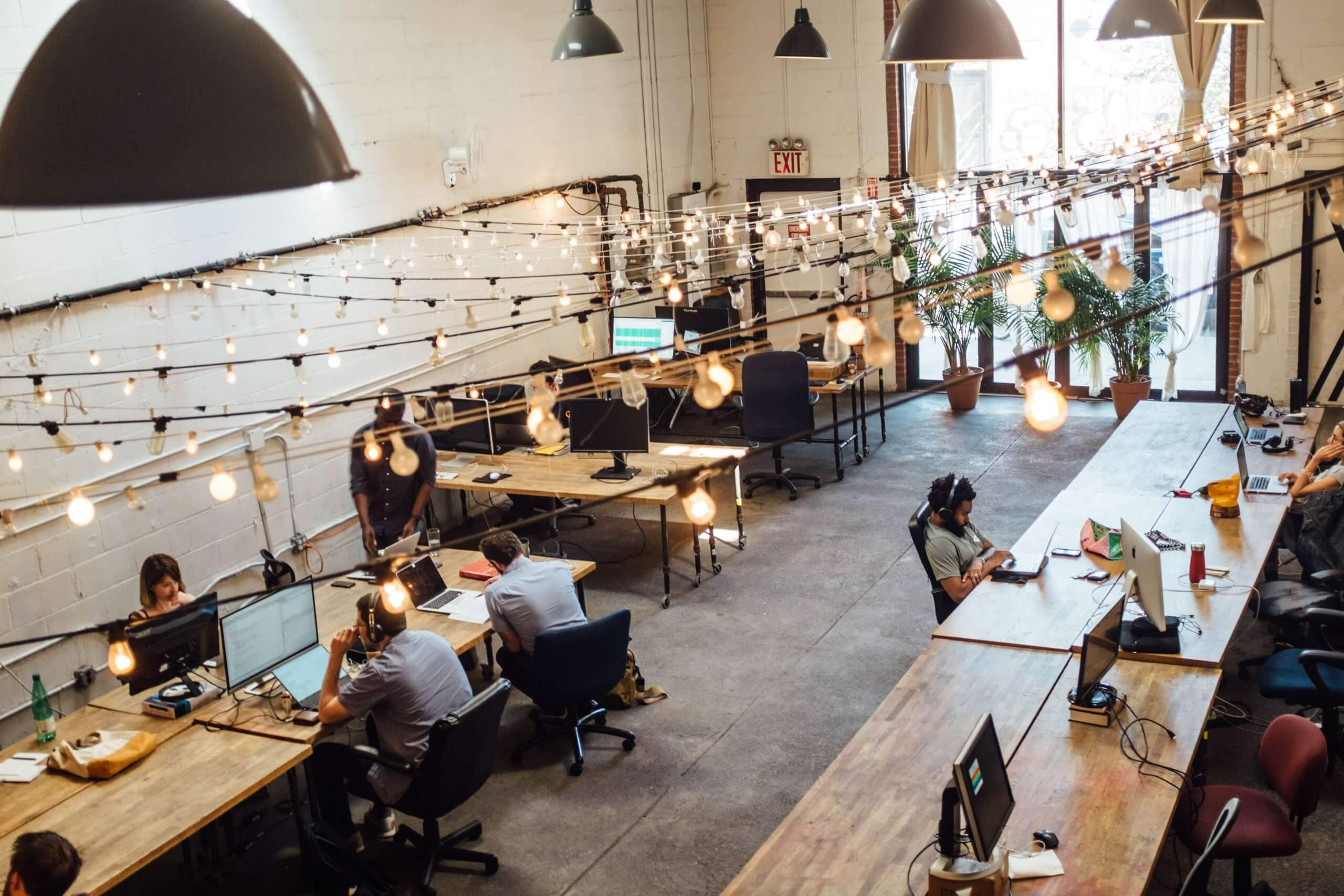 overhead view of people working in an open plan office